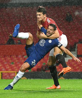 Harry Maguire fights with Cesar Azpilicueta (Oli Scarff / PA)
