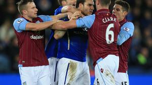 Leicester City's Matty James and Aston Villa's Ciaran Clark (second right) have to be separated before both being sent off