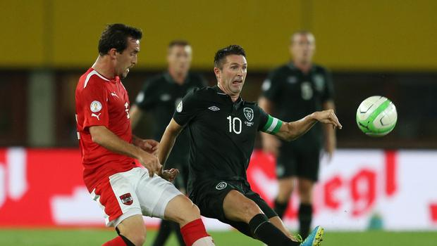 Leicester's Christian Fuchs, left, battles the Republic of Ireland's Robbie Keane in one of his 66 appearances for Austria.
