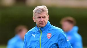 Arsene Wenger, pictured, is happy for Theo Walcott to step up his fitness with England