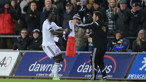 Bafetimbi Gomis, left, celebrated Swansea's equaliser with a tribute to the victims of the terrorist attacks in Paris