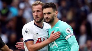 Harry Kane, left, has been tipped to fire Tottenham into Europe by his team-mate Hugo Lloris (Yui Mok/PA)