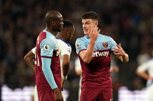 Declan Rice, right, and his West Ham team-mates are in a relegation battle (John Walton/PA)