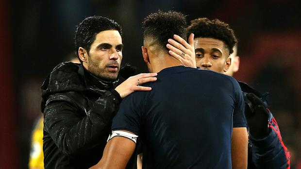 Arsenal's manager Mikel Arteta, left, called tor the Gunners to step up in the absence of Pierre-Emerick Aubameyang, right (Mark Kerton/PA)