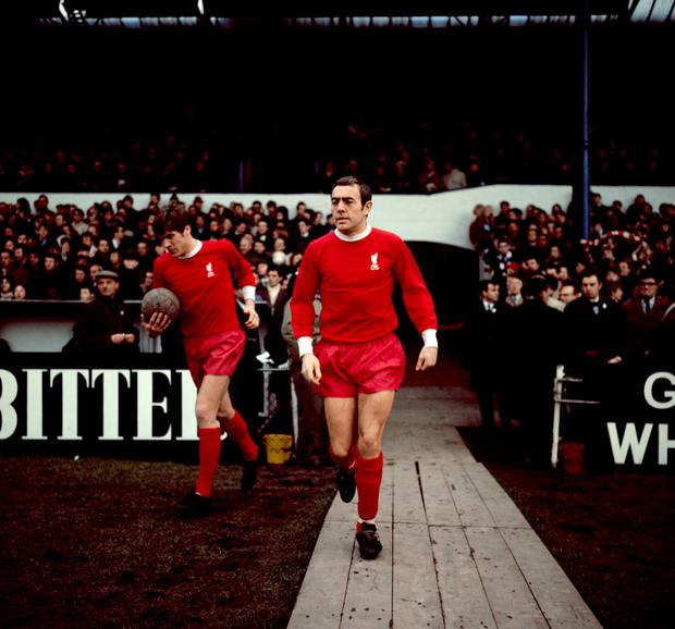 Ian St John (right) steps out for Liverpool along with Emlyn Hughes in 1969. Photo: PA