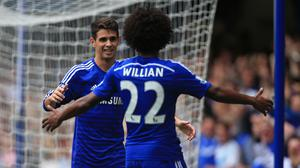 Chelsea's Oscar celebrates scoring the opening goal with Willian ,right,