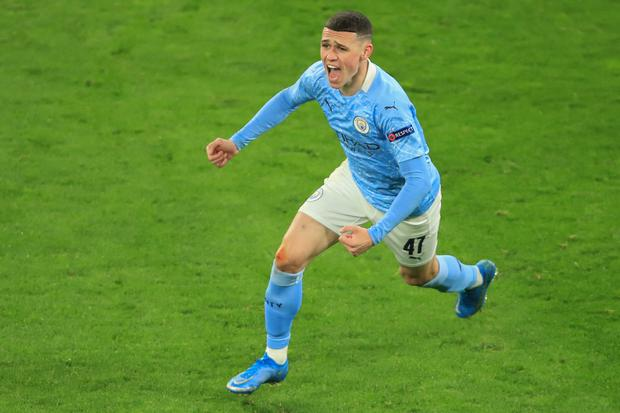 Manchester City's English midfielder Phil Foden celebrates scoring the 1-2 goal