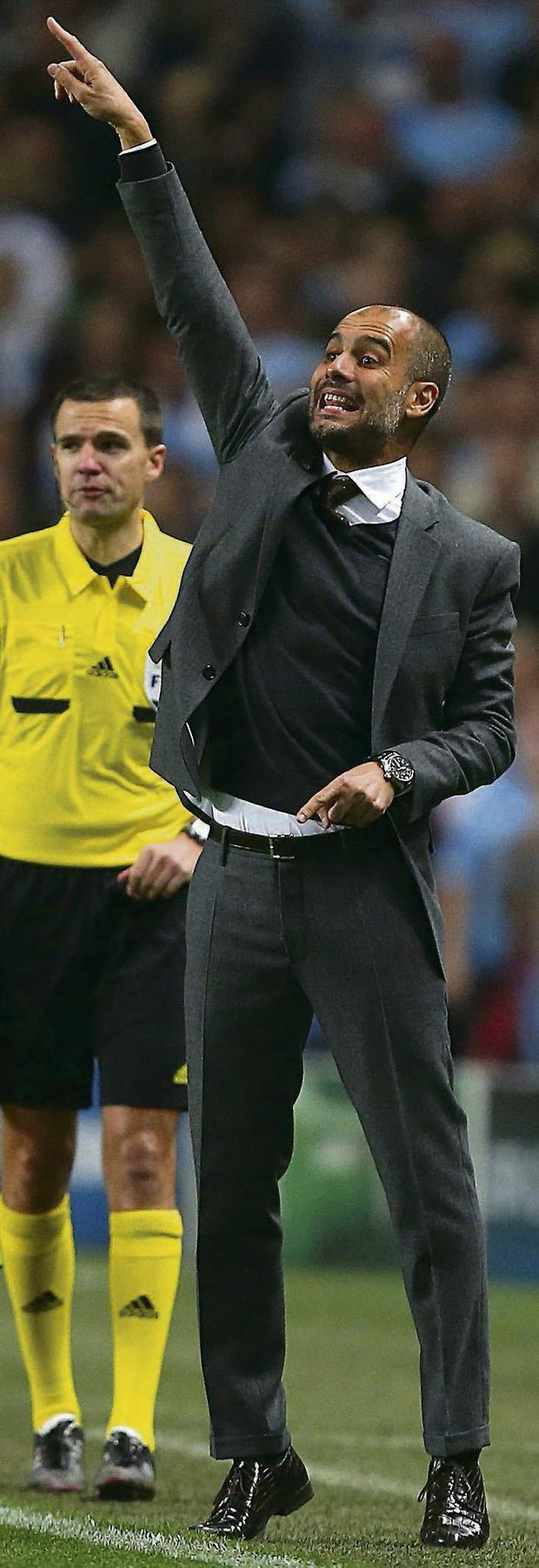 Bayern Munich manager Josep Guardiola gestures on the touchline during the UEFA Champions League match at the Etihad Stadium