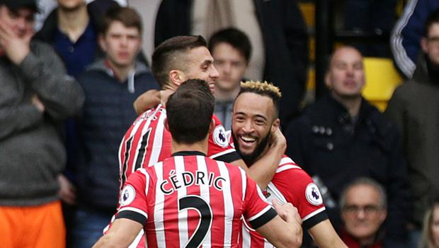 Nathan Redmond celebrates with his Southampton team-mates after scoring the first of two goals against Watford