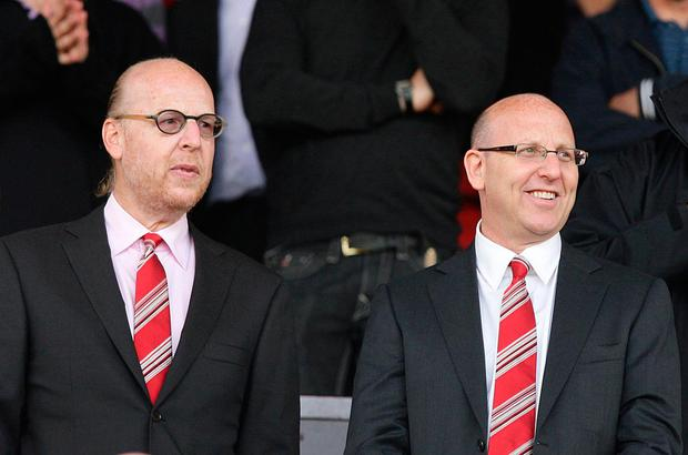 Manchester United fans have protested against how their club has been run under Joel Glazer (right), his brother Avram and the rest of the Glazer family