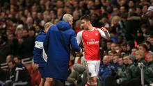 Olivier Giroud (right) says Arsenal's players want Arsene Wenger to stay
