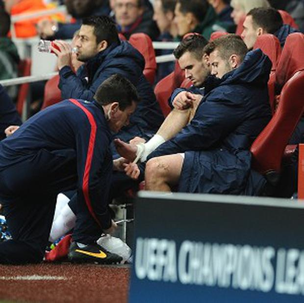 Jack Wilshere, right, injured his ankle during the midweek defeat to Borussia Dortmund