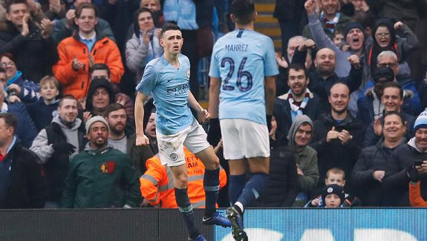 Phil Foden (left) was on target as Manchester City thrashed Rotherham (Martin Rickett/PA)