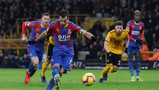 Crystal Palace's Luka Milivojevic scores their second goal at Molineux. (David Davies/PA)