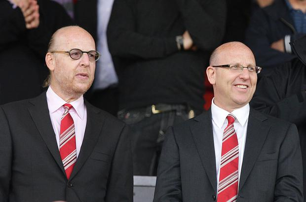 Joel Glazer, right, and Avram Glazer, are hoping to build bridges with Manchester United fans (Dave Thompson/PA)