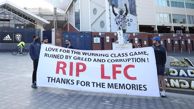 Liverpool fans made banners to protest against the European Super League (Zac Goodwin/PA)