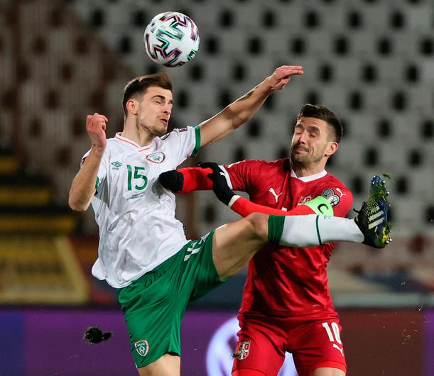 Jayson Molumby of Republic of Ireland battles for possession with Dusan Tadic of Serbia