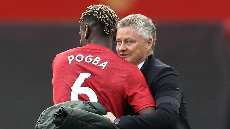 Manchester United manager Ole Gunnar Solskjaer celebrates with Paul Pogba. Photo: Martin Rickett/Reuters
