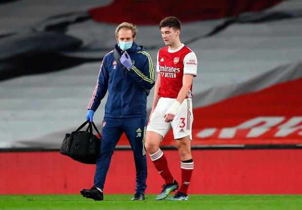 Arsenal's Kieran Tierney walks off the pitch after suffering a knee injury during his side's Premier League clash with Liverpool at The Emirates Stadium. Photo: Catherine Ivill/PA