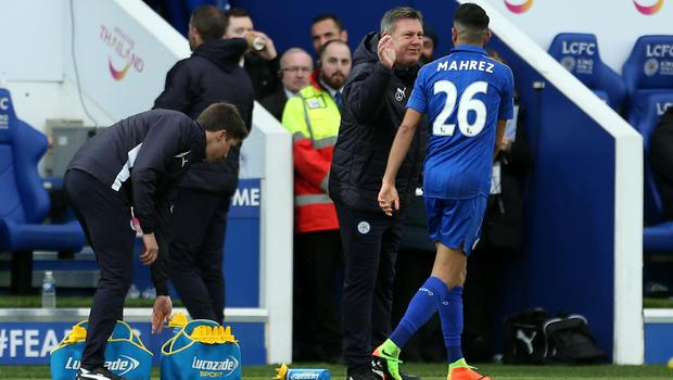 Riyad Mahrez, right, is congratulated by Craig Shakespeare after his goal against Hull