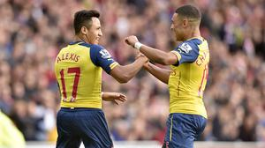 Arsenal boss Arsene Wenger saluted Alexis Sanchez, pictured left, after his match-winning double at Sunderland