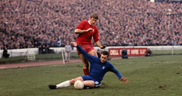 Chelsea's Ron Harris tackles Liverpool's Roger Hunt (PA)