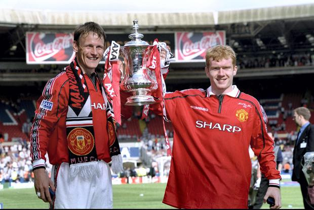 Teddy Sheringham and Paul Scholes celebrate Manchester United's FA Cup victory at Wembley in 1999