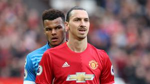 Tyrone Mings, left, is banned for five matches following his clash with Zlatan Ibrahimovic, right