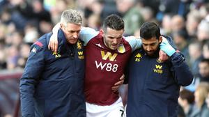 John McGinn being helped from the pitch against Southampton in December with what turned out to be a fractured ankle (Nick Potts/PA)