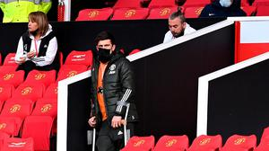 Manchester United's Harry Maguire on crutches in the stands during the Premier League match at Old Trafford on Tuesday night. Photo: Laurence Griffiths/PA