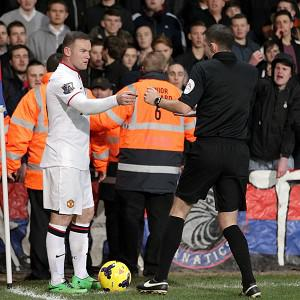 Manchester United's Wayne Rooney, left, was allegedly hit by a coin at Crystal Palace