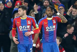 Jordan Ayew, right, reacts after scoring Palace's winner against Grimsby (Steven Paston/PA)