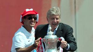 Arsenal manager Arsene Wenger (right) wants Theo Walcott to get game-time with England.