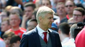 Arsene Wenger watched Arsenal win 4-1 on Sunday.