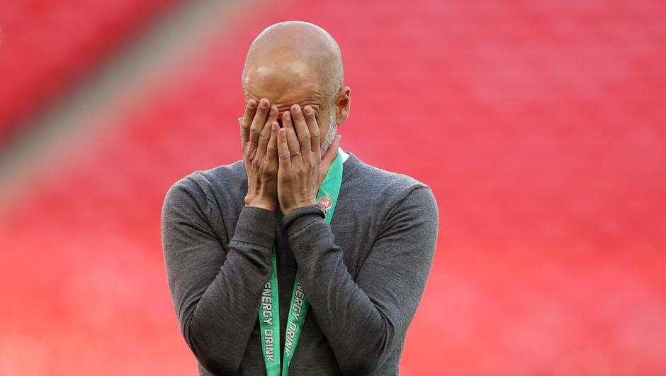 Manchester City manager Pep Guardiola reacts after winning the Carabao Cup final. Photo: Carl Recine/Reuters