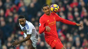 Joel Matip, right, in action for Liverpool