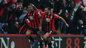 Joshua King, left, celebrates his hat-trick as Bournemouth snatched a last-gasp win