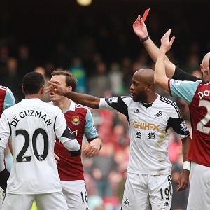 Andy Carroll (left) saw red against Swansea