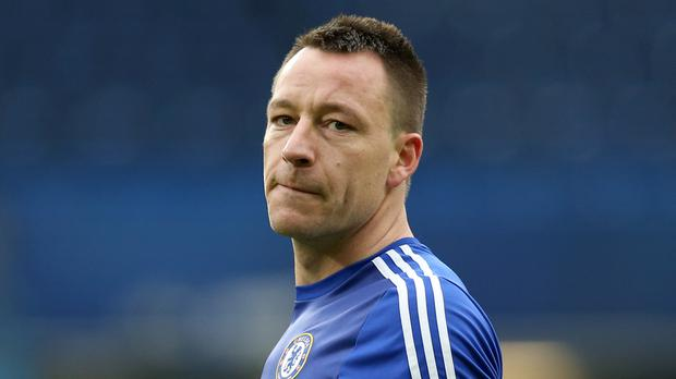 Chelsea interim boss Guus Hiddink has advised John Terr, pictured, to play on for as long as possible if he wishes to be a manager