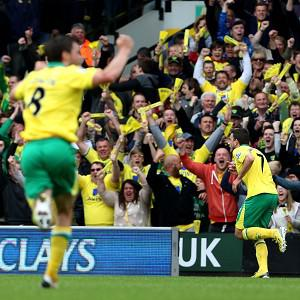 Norwich secured Premier League status with a crushing win over West Brom