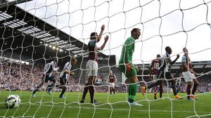 West Bromwich Albion's Saido Berahino runs away after scoring their second goal, as Burnley goalkeeper Thomas Heaton shows his dejection during the Barclays Premier League match at The Hawthorns, West Bromwich. PRESS ASSOCIATION Photo. Picture date: Sunday September 28, 2014. See PA story SOCCER West Brom. Photo credit should read: Nick Potts/PA Wire. RESTRICTIONS: Editorial use only. Maximum 45 images during a match. No video emulation or promotion as 'live'. No use in games, competitions, merchandise, betting or single club/player services. No use with unofficial audio, video, data, fixtures or club/league logos.