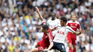 Tottenham Hotspur's Paulinho and West Bromich Albion's Graham Dorrans battle for the ball during during the Barclays Premier League match at White Hart Lane, London.