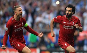Henderson, left, celebrates with Mohamed Salah after the opening goal (Mike Egerton/PA)