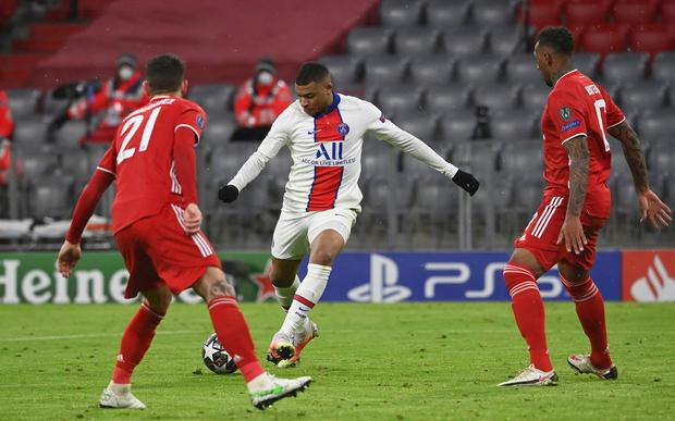 PSG's Kylian Mbappe scores his side's third goal during the Champions League quarter-final first leg win over Bayern Munich. Photo: Sven Hoppe/DPA