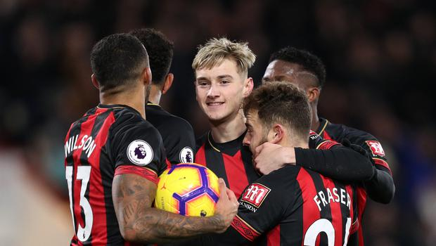 Bournemouth's Ryan Fraser (right) celebrates scoring his side's third goal of the game during the Premier League match at the Vitality Stadium, Bournemouth.