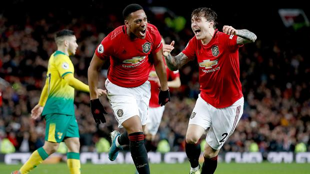 Manchester United remain top dogs in England in terms of generating revenue but could be surpassed by Manchester City or Liverpool in next year's Money League (Martin Rickett/PA)