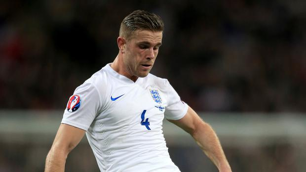 England midfielder Jordan Henderson, pictured, has backed his Liverpool manager Brendan Rodgers