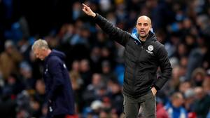 Pep Guardiola has insisted he will stay and fight for the club despite the European ban (Martin Rickett/PA)
