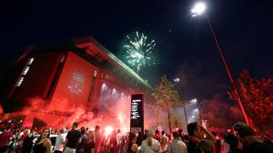 Liverpool fans celebrate outside Anfield (Peter Byrne/PA)
