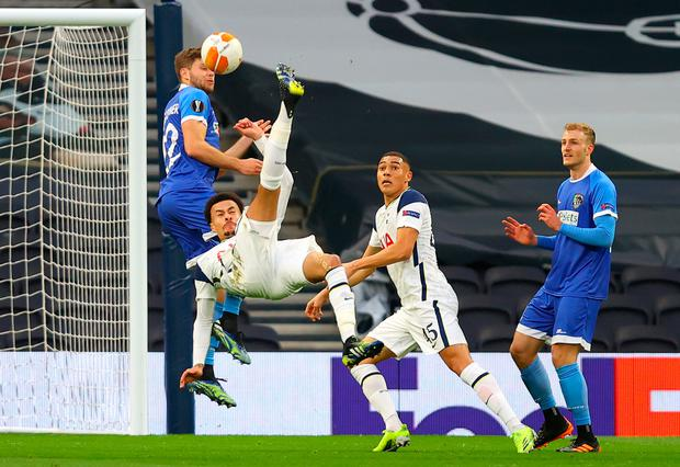 Dele Alli of Tottenham Hotspur scores their first goal with a overhead kick during the UEFA Europa League Round of 32 match win over Wolfsberger AC (Photo by Julian Finney/Getty Images)